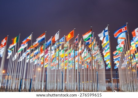 national flags of countries all over the world at night - stock photo