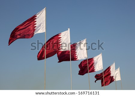 National flags of Qatar - stock photo