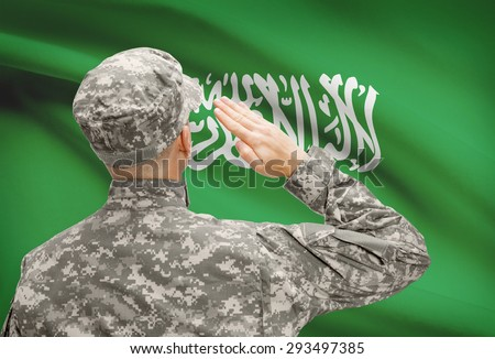 National military forces with flag on background conceptual series - Saudi Arabia - stock photo