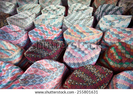 National Nepalese tribal caps Topi at the market. A topi is a cap that is worn in India, Bangladesh, Pakistan, and other regions of South Asia.  - stock photo