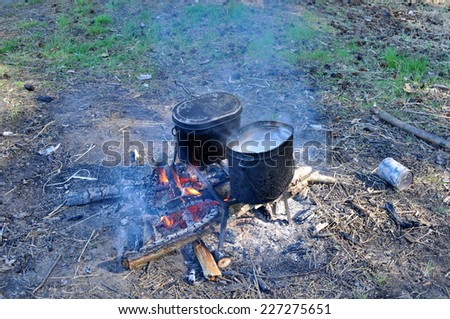 "National Park ""Meshchera"", Ryazan region, Russian Federation. Cooking on camp fire. - stock photo"