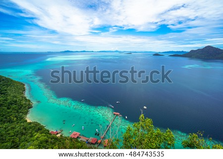 National Park on top of Bohey Dulang island near Sipadan Island,Sabah,Borneo.Mirror smooth ocean surrounded by mountains.The bright blue water and rocky shore in the tropical island of Semporna,Borneo