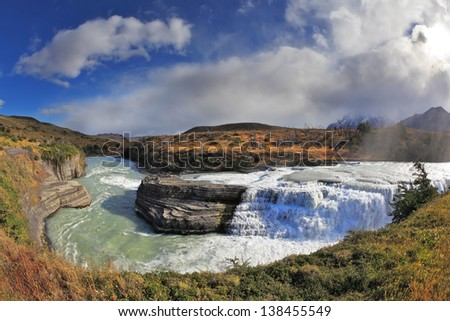 National Park Torres del Paine in Chile. Cascades Paine-rock in the middle of the Rio Paine forms a raging waterfall