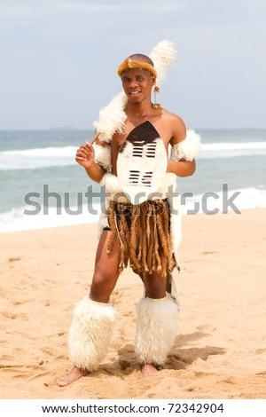 native african man on beach - stock photo