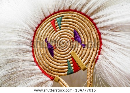 Native Alaskan dancing fan made out of fox fur and woven grass. - stock photo