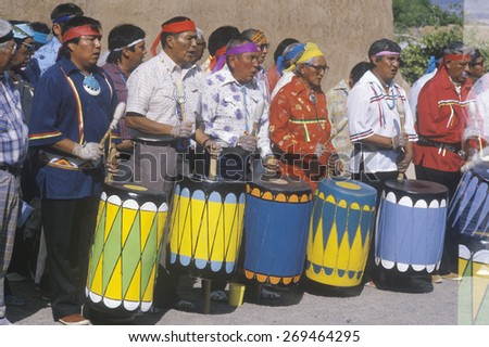 Native American elders drumming during Corn Dance ceremony in Santa Clara Pueblo, NM - stock photo