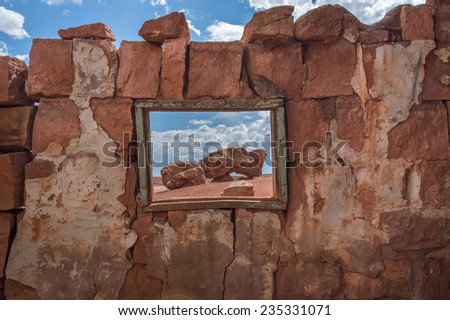 Native American home in Cliff Dwellers, located in Northern Arizona at Marble Canyon and at the foot of Vermillion Cliffs, is known for its unique shaped boulders and rugged terrain. - stock photo