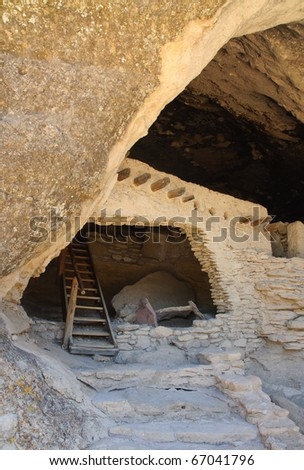 native american indian ruins in a rock overhang - stock photo