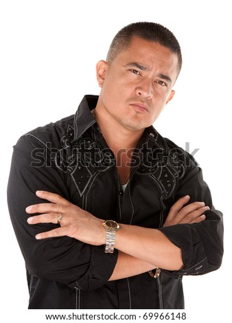 Native American looking tough with folded arms on white background