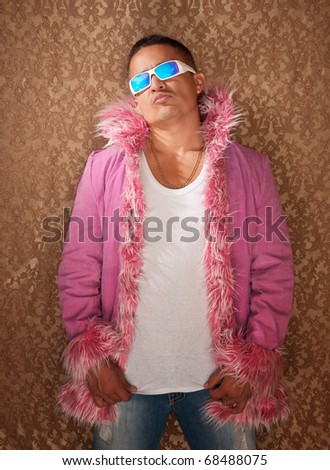 Native American male rockstar with sunglasses and a pink fluffy jacket - stock photo