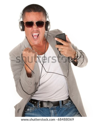 Native American Man dances to music from his MP3 player - stock photo