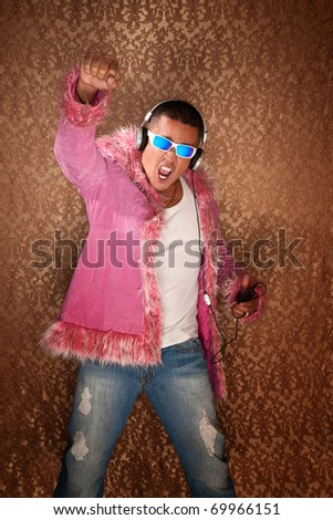 Native American Man in pink jacket enjoys to music from his MP3 player - stock photo
