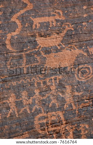 Native American petroglyph on canyon wall - Valley of fire SP - stock photo