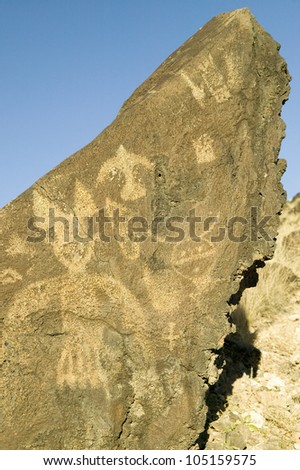 Native American petroglyphs at Petroglyph National Monument, outside Albuquerque, New Mexico - stock photo