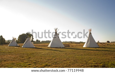 Native American Tee Pees in the morning - stock photo