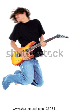 Native American teen boy Jumping With Electric bass Guitar.  Motion blur in head and upper body.