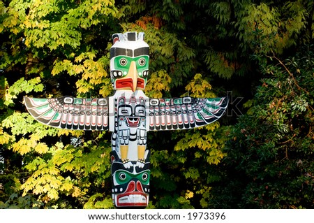 Native american totem poles  in Stanley park, Vancouver, Canada - stock photo