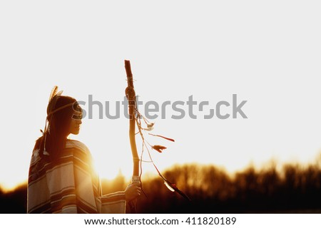 native american woman  shaman with pikestaff on background of sunset beutiful in mountains - stock photo