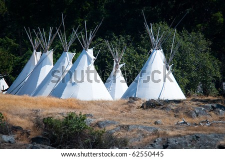 Native americans tipis on one of the Puget Sound islands in Washington - stock photo