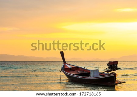 native boat on beach and sunrise in morning at Trang ,Thailand - stock photo