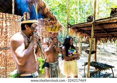 Native Brazilian group playing wooden flute at an indigenous tribe in the Amazon - stock photo