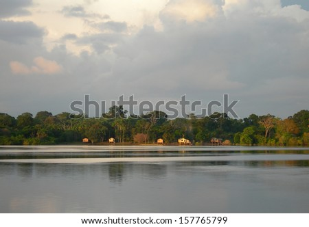 Native homes on the banks of the Rio Negro in the Amazon River basin, Brazil, South America           - stock photo