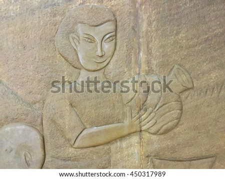 Native Thai culture stone carving on wall