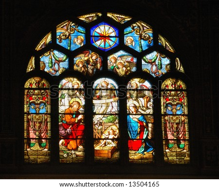 Nativity scene in stained glass church window. - stock photo