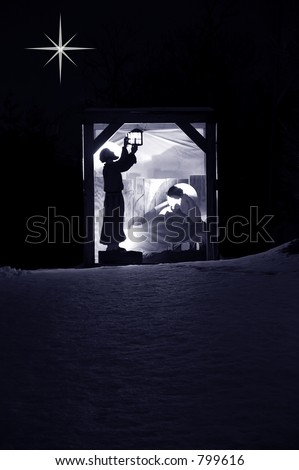 Nativity scene on a hill in the snow.  Joseph of Nazareth lights the lantern and Mary tends to her baby, Jesus. - stock photo