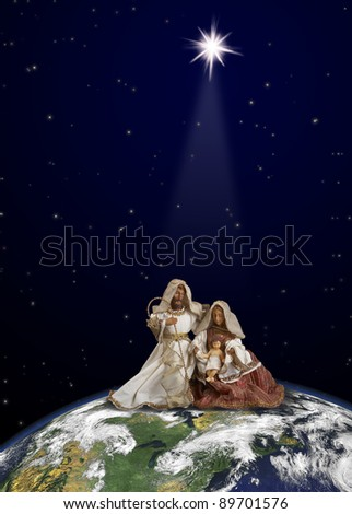 Nativity scene with Jesus, Maria and Joseph  at  globe top on space background under Christmas star beam. World map courtesy of NASA.