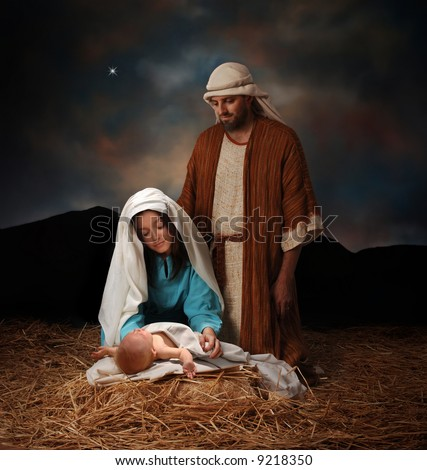 Nativity scene with Mary, Joseph and baby Jesus looking into hills in the distance - stock photo