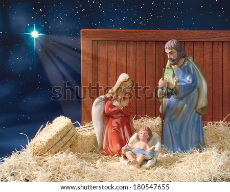 Nativity Scene with Star of David at Night with Hay and Barn Board - stock photo