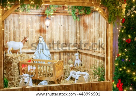 Nativity scene with the holy family of Joseph, Mary, baby Jesus and sheep, holiday decorations in the Old City at night. Prague. Czech Republic. - stock photo