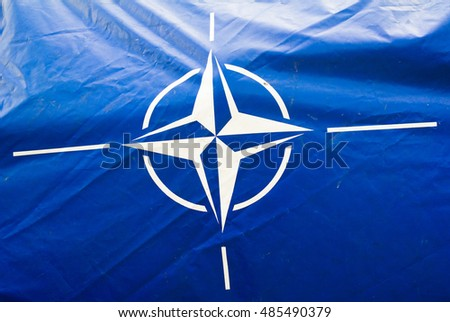 NATO DAYS, OSTRAVA MOSNOV, CZECH REPUBLIC - SEPTEMBER 18, 2016: Dirty and wrinkled blue canvas with flag of NATO ( North Atlantic Treaty Organization ). Alliance of defence against enemies