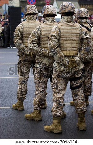 NATO (Latvian) soldiers at the Military parade of the National Armed Forces at the embankment of the 11th November. 89th anniversary of establishment of the Republic of Latvia