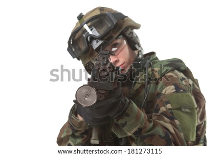 NATO soldier in full gear. Military woman isolated over white background.