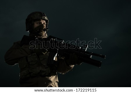 NATO soldiers patrol the area. Military against the sky - stock photo