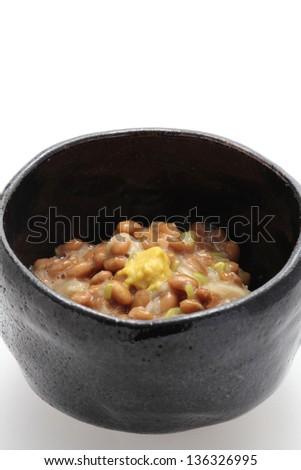 Natto, fermented soybeans on white background - stock photo
