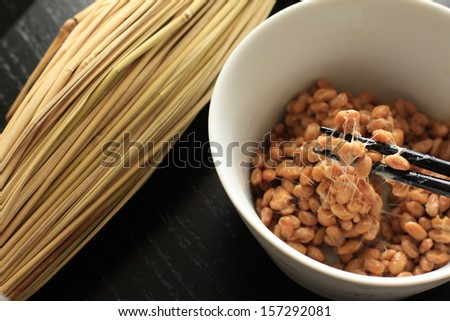 Natto in a bowl with chopsticks - stock photo