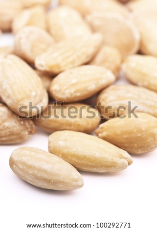 Natural almonds, peeled, over white background - stock photo