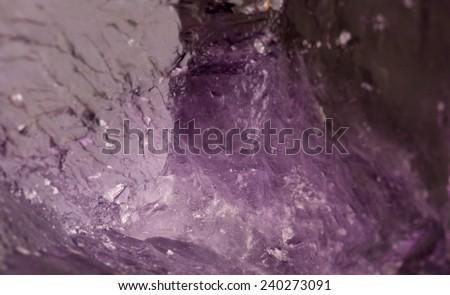Natural Amethyst crystal gem stone close-up macro - stock photo
