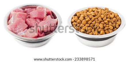Natural and dry food for pets in metal bowls isolated on white background. - stock photo