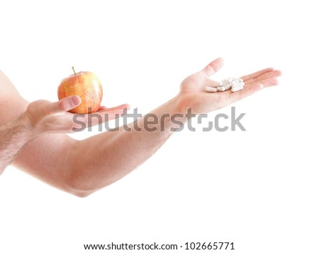 natural apple vitamin or pill drag tablet Man isolated offering pill in one and pills in bottle - in another hand. Copy space boxes with supplements - stock photo