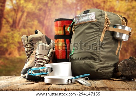 natural autumn space and backpack  - stock photo
