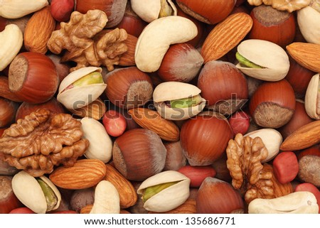 Natural background made from different kinds of nuts - stock photo