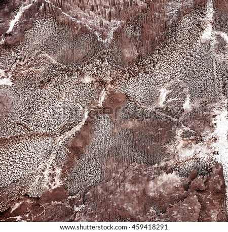 Natural background of  texture of of crystals of salts on the surface of the rock