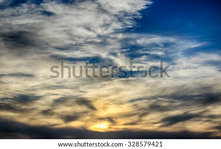 Natural background with red sunset and dark ominous clouds.HDR image