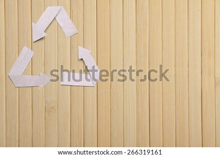 natural bamboo texture, wooden backgroud and paper recycle symbol - stock photo