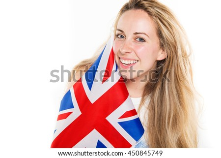Natural beautiful blonde young woman supporter laughing holding a United Kingdom union jack flag in front of body stock photography