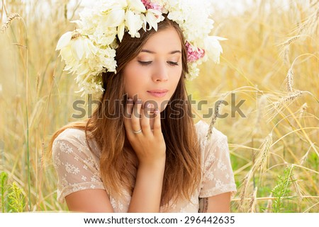 Natural beauty. Beautiful girl in a wheat field